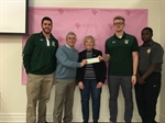 Timon Football Makes Donation For Cancer Research